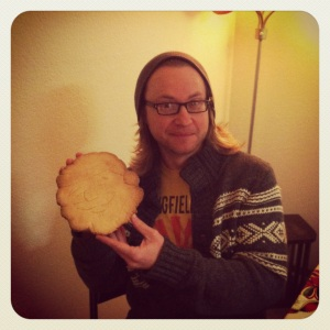 ray showing off his giant sugar cookie